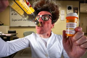 Mad professor holds an experiment